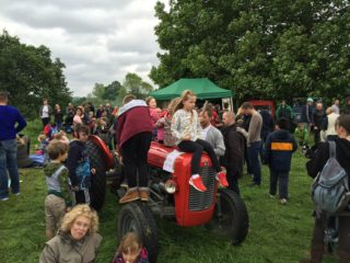 Playing on the tractor, Duck Race 2016